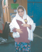 The author dressed as a young Jewish woman for the Schoolcraft Learning Community's Auschwitz re-enactment