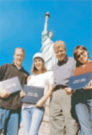 Ryan, Cassie, Gary Knox, and Trina of Liberty High commemorate the class of 2003 at the Statue of Liberty